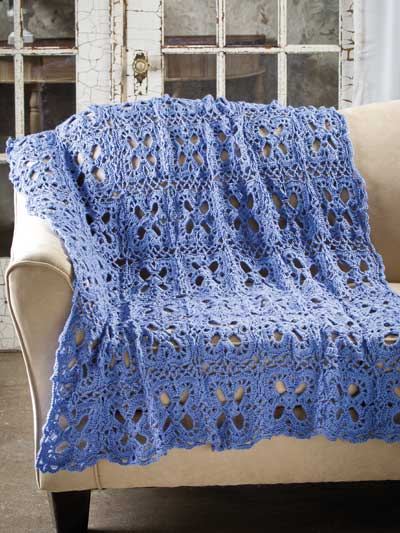 Stitched in the color of wild bluebonnets, this lacy throw works up ...